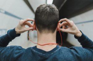 man-wearing-earphone