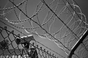 berbed-wire-fence-and-observation-camera