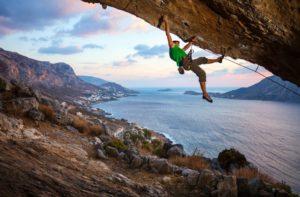 climber-climbing-overhanging-cliff