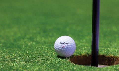 golf-ball-near-hole