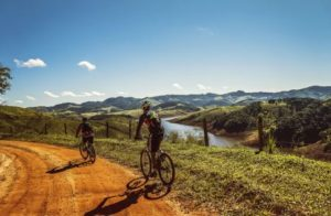 people-on-road-bike-on-the-hill