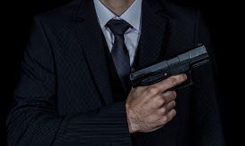 person-holding-gun