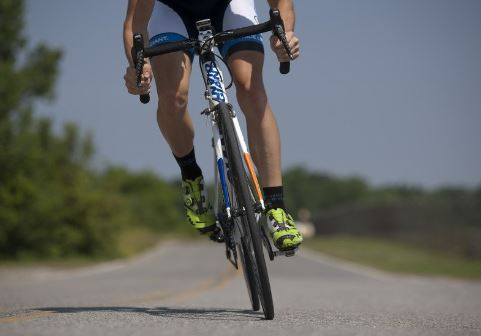 person-riding-road-bike-on-the-road