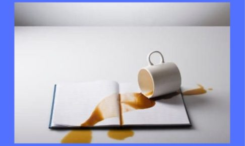 spilled-coffee-on-book-blue-background