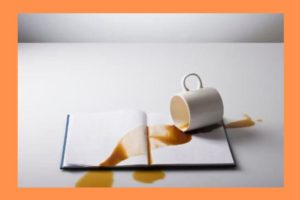 spilled-coffee-on-book-orange-background