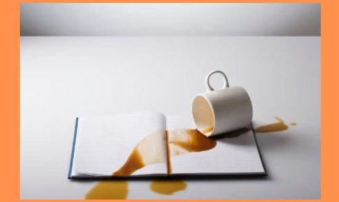 spilled-coffee-on-book-orange-background