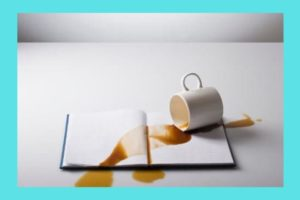 spilled-coffee-on-book-palegreen-background