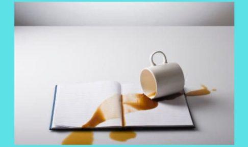 spilled-coffee-on-book-palegreen-background