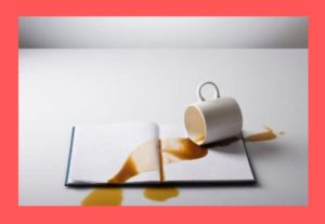 spilled-coffee-on-book-red-background