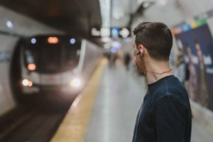 the-man-wearing-earphone-at-the-subway