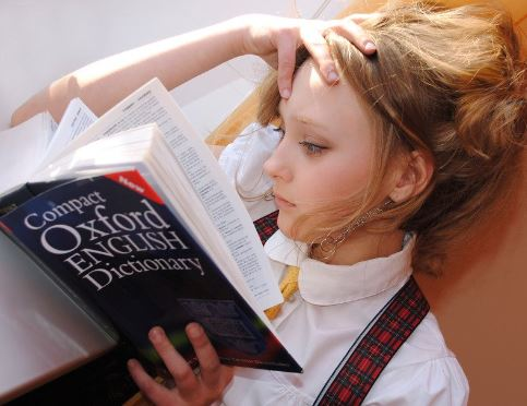 girl-reading-oxford-english-dictionary