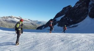 three-person-walking-on-the-mountain
