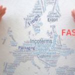 hands-enclose-europe-shaped-word-cloud-incoterms-and-trade-words-incoterms-fas